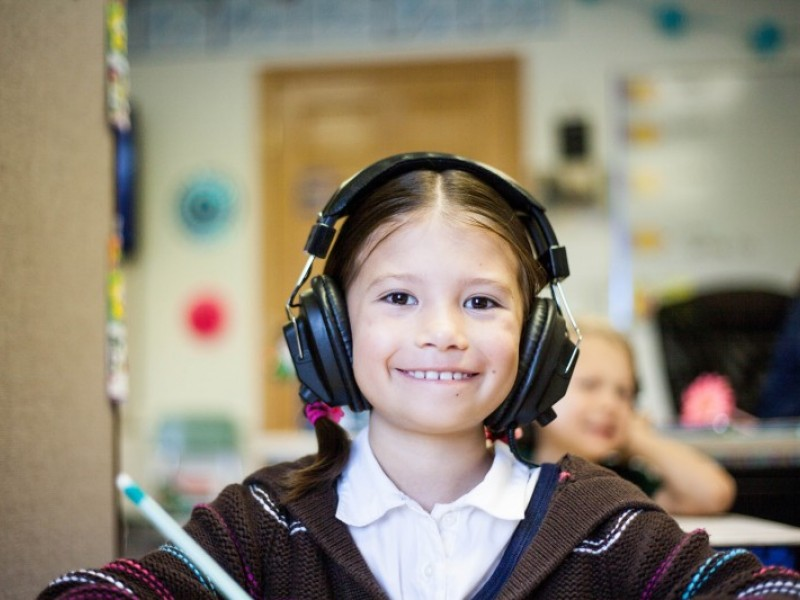 Smiling young girl with headphones on
